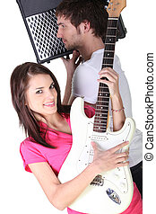 girl and boy in a music band
