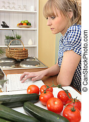 Woman looking for online recipe