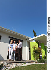 Young couple viewing potential house purchase