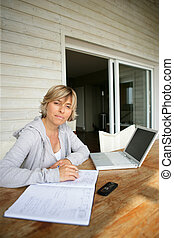 Woman using a laptop at home