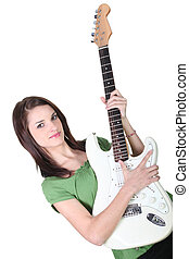 Girl playing guitar, studio shot