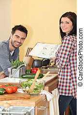 Couple preparing home cooked meal