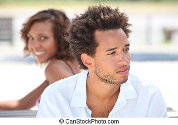Woman looking at her pensive boyfriend