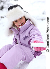 Little girl sitting on the snow