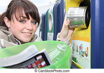 Woman recycling household waste
