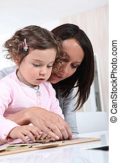 Woman and child playing with a jigsaw puzzle