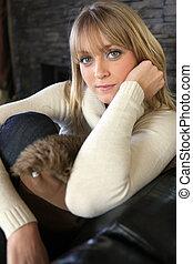 Woman on a comfortable sofa