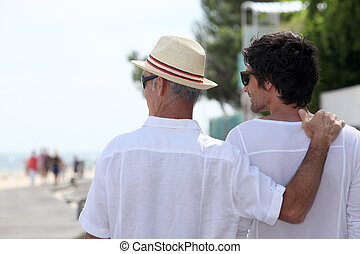 Father and son on boardwalk