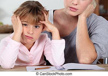 Little girl bored of her homework