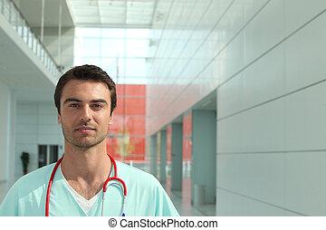 Doctor in hospital corridor