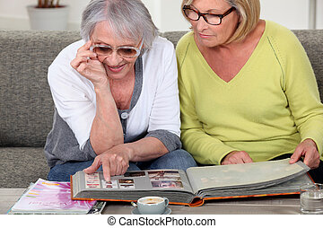 Senior people looking at pictures