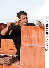 Man hitting wall with mallet