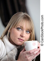 Blond woman relaxing with coffee
