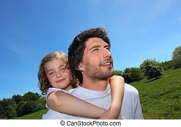 Man giving daughter piggyback