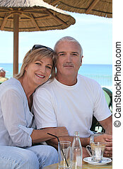 senior couple on beach terrace