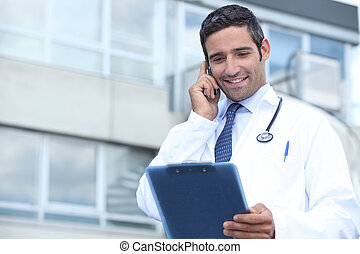 Young doctor stood outside hospital