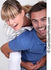 Man giving girlfriend piggyback