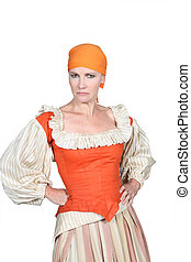 Woman in pantomime outfit, frowning with her hands on her...