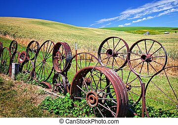 Steel Wheel Fence Green Wheat Grass Fields Blue Skies...