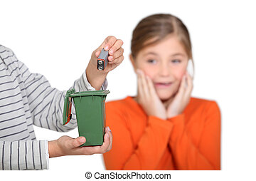 Girl horrified at someone putting a battery in the bin
