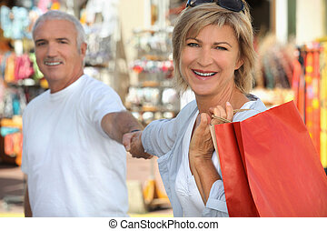 Mature couple shopping