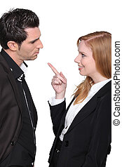 Businesswoman pointing at man