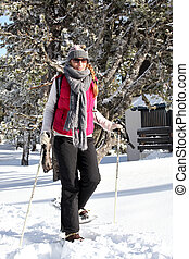 Woman wearing snow shoes