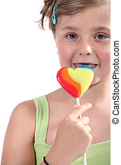 Little girl with a lolly
