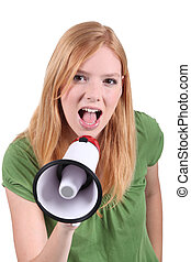 Young woman speaking into megaphone
