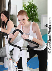 Woman cycling in the gym