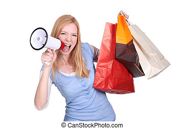 woman holding shopping bags and screaming through a...