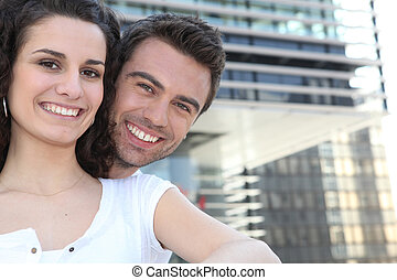 Couple in front of modern building