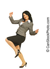 Successful business woman raising fists and being happy...