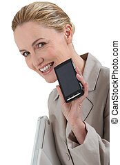 Smiling woman with a mobile phone