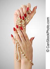 Red manicure - Beautiful female hands