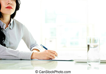 Taking business notes - Business woman taking notes at...