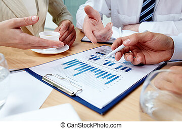 Business discussion - Business people in the middle of an...