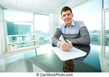 White collar worker - Cheerful young man signing business...