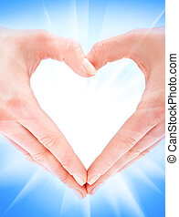 In form of heart - Female hands forming a heart against...