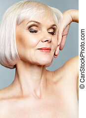 Glamorous mature lady - Portrait of a nude mature lady with...