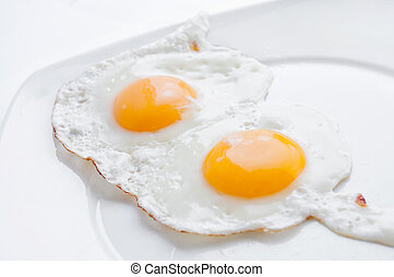 Double fried egg - Clouse up double fried egg on the white...