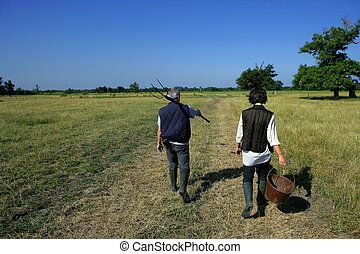 Farming couple in a field