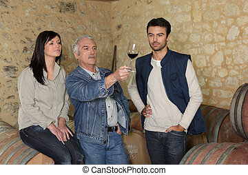 Winemakers examining a glass of wine