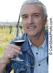 Man with glass of red wine