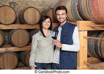 Couple tasting a wine in a winery