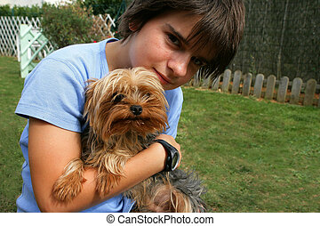 Preteen boy hugging his dog