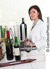 Oenologist analyzing a wine