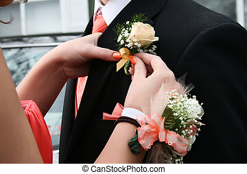 Prom - Pinning a corsage to his lapel for the Prom.