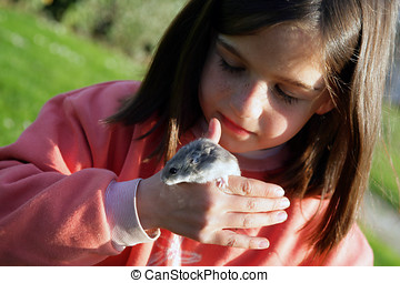 Little girl with a mouse