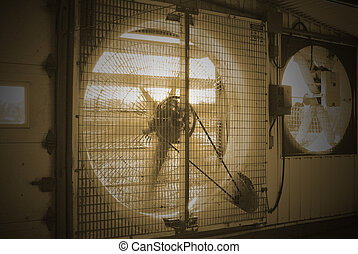 fan - This is a fan blowing air from the inside of a farm.